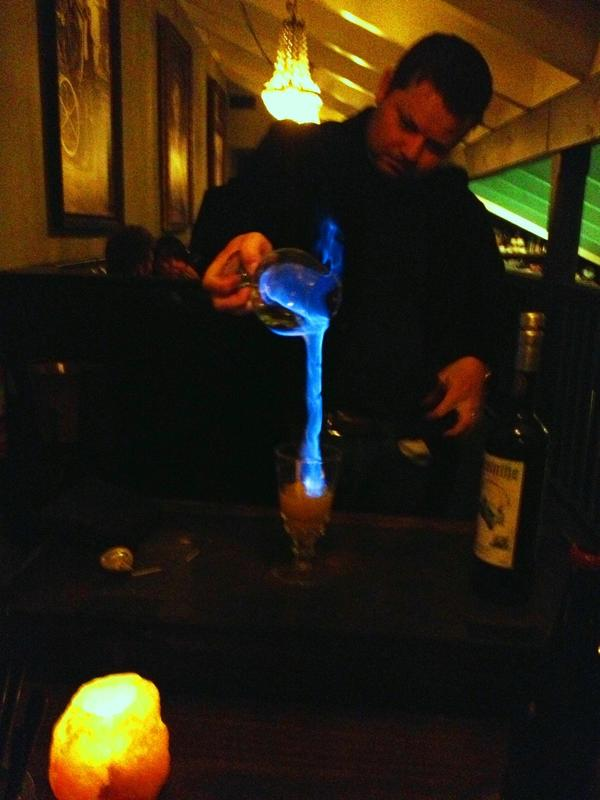 General manager Tobias Peach flames absinthe at Restaurant 1833.