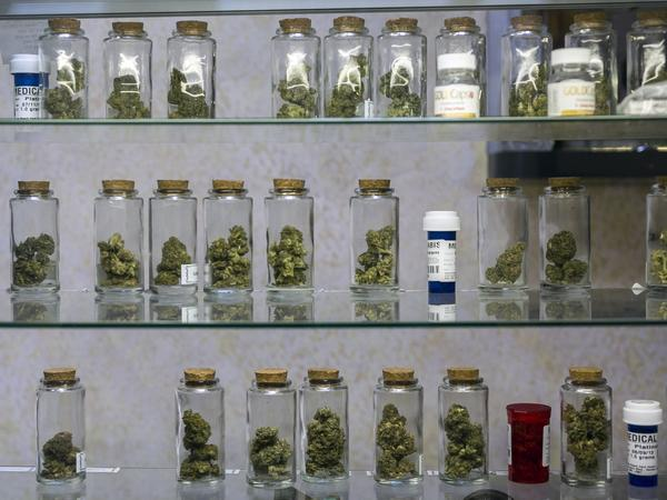 Vials of pot are displayed at the Venice Beach Care Center medical marijuana dispensary in Venice, Calif.