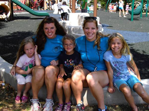 Camp counselors Lindsay Ryan and Rachael Messmore pose with kids at the Wheaton Park District's summer camp.