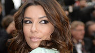 Eva Longoria revealed a bit more than she realized when she was trying to save her dress from the rain at the Cannes Film Festival in France.