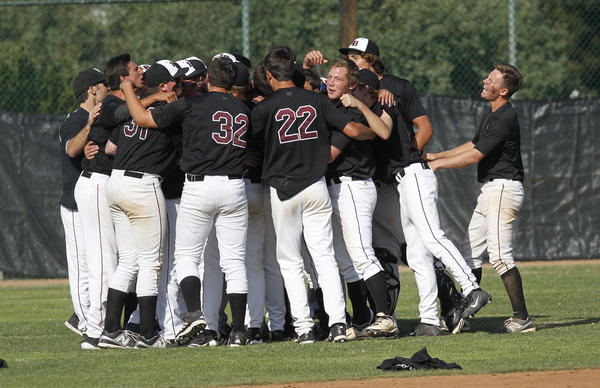 Laguna players gather after game as they celebrate a dramatic come from behind win during CIF-SS Division-4 baseball playoff game vs. Victor Valley on Friday.