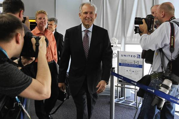 Boeing Co. CEO Jim McNerney exits a 787 Dreamliner after it landed Monday at O'Hare International Airport. The flight marked the return to service of United-owned Dreamliners after the Boeing model was grounded for 100 days by aviation regulators worldwide because of overheating onboard batteries.