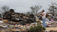 MOORE, Okla. (AP) - Search and rescue crews worked through the night after a monstrous tornado barreled through the Oklahoma City suburbs, demolishing an elementary school and reducing homes to piles of splintered wood. At least 51 people were killed, including at least 20 children, and those numbers were expected to climb, officials said Tuesday.