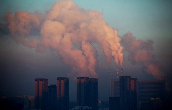A power plant discharges pollution into the air in China. The burning of fossil fuels has contributed to an unprecedented buildup of carbon dioxide in Earth's atmosphere.