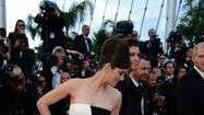 "Marion Cotillard wore a strapless Dior gown with eye-catching color blocks of blue, yellow, black and pink on a white background to the Cannes Film Festival premiere of ""Blood Ties"" on Monday. The dress was shown Saturday in Monaco as part of Dior's Cruise Collection 2014 — a fashion show attended by Cotillard, Jessica Biel and Ruth Wilson, among others.  <a href=""http://www.hollywoodreporter.com/news/cannes-fashion-marion-cotillard-christian-525710"">[Hollywood Reporter]</a>"