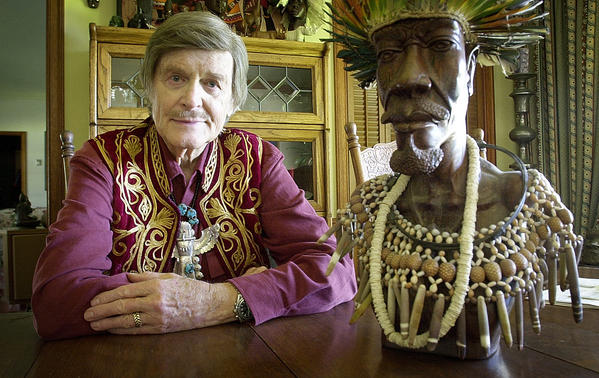 Explorer John Goddard poses in 2005 with an artifact collected on one of his many adventures. Goddard, a longtime La Canada Flintridge resident, died last week at the age of 88.
