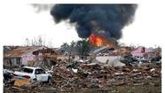 MOORE, Oklahoma - A monstrous tornado at least a half-mile wide roared through the Oklahoma City suburbs Monday, flattening entire neighborhoods and destroying an elementary school with a direct blow as children and teachers huddled against winds up to 200 mph. At least 51 people were killed, and officials said the death toll was expected to rise.