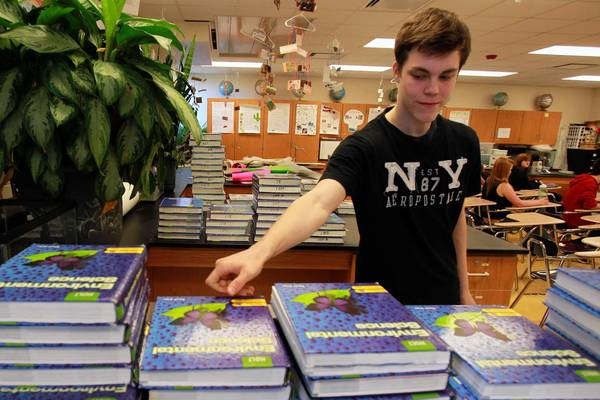 David Johnson, 16, a junior, returns his environmental science book at Wauconda High School on Thursday. The school year finishes on one of the earliest release dates for schools.