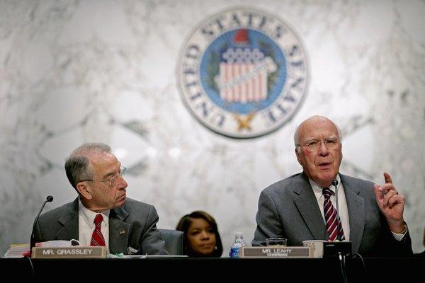 Sen. Charles Grassley (R-Iowa), left, and Senate Judiciary Committee Chairman Patrick Leahy (D-Vt.) during a committee meeting on immigration reform.