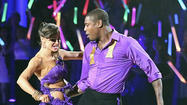 Jacoby Jones begins the finales tonight coming down the staircase in purple and gold, with partner Karina Smirnoff in a purple dress -- a nice nod to Jacoby's hometown of New Orleans.
