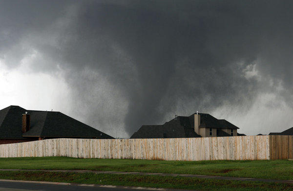 Massive tornado rakes Moore, Okla., on Monday.