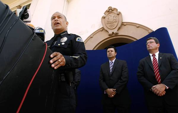 Huntington Park Police Chief Jorge Cisneros, left, announces that three Los Angeles men have been charged with federal crimes in a bank robbery that occurred in Los Angeles on Sept. 5, 2012, as Huntington Park City Manager Rene Bobadilla and Timothy Delaney, special agent in charge of the FBI's Criminal Division at the Los Angeles Field Office, right, look on during a news conference in Huntington Park.