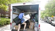 Loading his earthly belongings into a laundry cart that he rented from Campus Services, Johns Hopkins University freshman Austin Dennis made several trips from his dormitory room to his car on residential Greenway at North Charles Street, opposite the Homewood campus May 15.