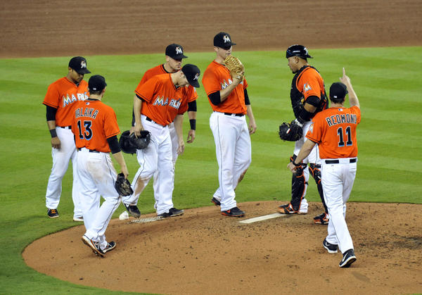 May 1, 2013; Miami, FL, USA; Miami Marlins manager Mike Redmond (11) signals for a pitching change in the sixth inning against the New York Mets at Marlins Park. The Mets won 7-6. Mandatory Credit: Steve Mitchell-USA TODAY Sports ORG XMIT: USATSI-121136