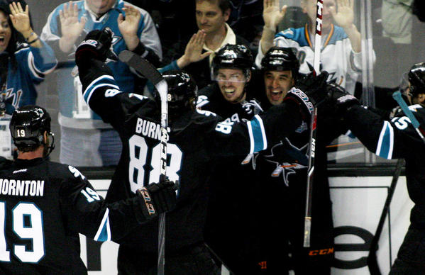 The San Jose Sharks celebrate after scoring an overtime goal to beat the Kings in Game 3.