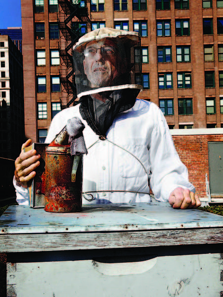 Urban beekeeper Michael Thompson, farm manager/director of the Chicago Honey Co-Op, seen here on the rooftop of the Chicago Cultural Center on Tuesday, April 16, 2013. Thompson tends the 4 hives on the roof of the Chicago Cultural Center.