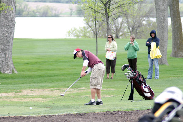 Aberdeen Christian's Matt Rohrbach putts the ball on to the ninth green during the first round of the Class B state boys' golf tournament on Monday at Brookings Country Club. Rohrbach carded a 9-over-par 81 and is five shots back. Brookings Register Photo by Sean Welsh