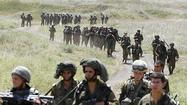 JERUSALEM (Reuters) - Israeli troops shot at a target across the Syrian frontier on Tuesday in response to gunfire that struck its forces in the Golan Heights, the Israeli military said.