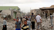 KIRKUK, Iraq (Reuters) - Several bomb blasts killed at least 12 people in Iraq on Tuesday, police said, a day after more than 70 died in attacks on majority Shi'ites, stoking fears of all-out sectarian war with minority Sunnis.