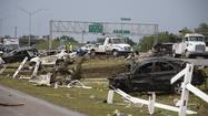Destroyed cars are seen along Interstate 35 after a tornado struck Moore, Oklahoma