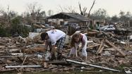 A couple searches for belongings after a tornado struck Moore, Oklahoma