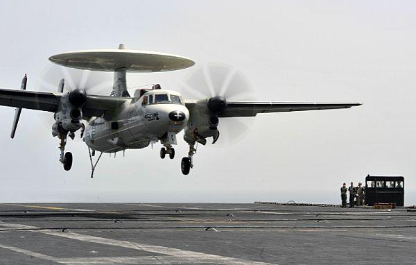 An E-2C Hawkeye prepares to land on the flight deck of the U.S. aircraft carrier Abraham Lincoln in the Persian Gulf.