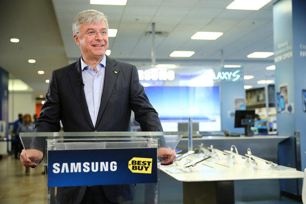 Best Buy CEO Hubert Joly celebrates the opening of the Samsung Experience Shop at a Best Buy in New York on April 24. The electronics retailer reported slumping first-quarter profit and sales on Tuesday.