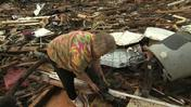 Video: Woman reunited with dog amid tornado wreckage