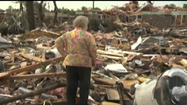 Tornado survivor finds dog in rubble [Video]