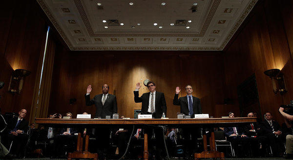 Left to right, J. Russell George, Treasury inspector general for tax administration; acting IRS Commissioner Steven T. Miller; and former IRS Commissioner Douglas Shulman are sworn in prior to testifying before the Senate Finance Committee.