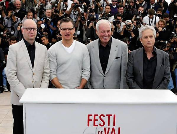 "Director Steven Soderbergh and cast members pose during a photocall for the film ""Behind the Candelabra"" at the 66th Cannes Film Festival in Cannes."