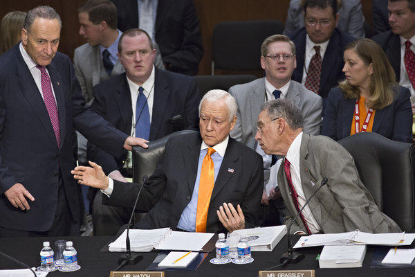 From left, Sen. Charles E. Schumer (D-N.Y.), Sen. Orrin G. Hatch (R-Utah) and Sen. Chuck Grassley (R-Iowa) confer as the Senate Judiciary Committee meets on immigration reform on Capitol Hill.