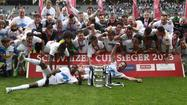 Grasshopper players celebrate with trophy after winning Swiss Cup final soccer match against FC Basel in Bern