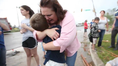 Video: Mother's tearful reunion with her son after tornado