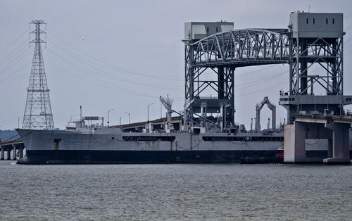 USS Merrimack (AO-179) passes through the James River Bridge, a National Defense Reserve Fleet non-retention vessel,  departed the James River Reserve Fleet for recycling at Southern Recycling LLC., located in New Orleans, Louisiana.