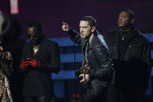 Eminem collects a Grammy Award at Staples Center in February 2011. The company that licenses his songs says Facebook infringed on its copyright.