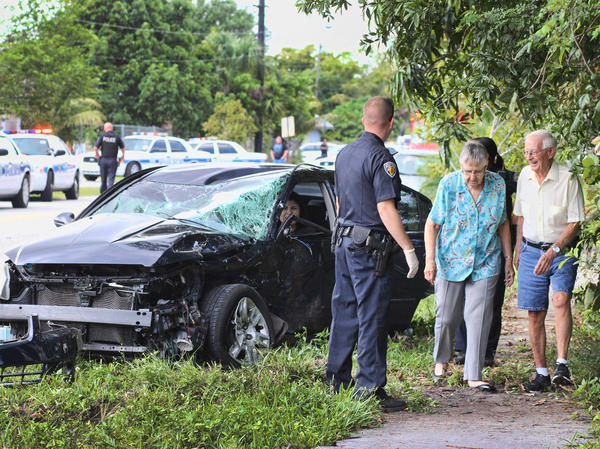 Rescue workers help treat passengers on a Broward Transit bus after is had extensive front end damage. The bus driver, Joseph Accilien of Miramar, was seriously hurt and the other car's driver had to be extricated and was also injured. All totaled 5 people were transported to an area hospital.