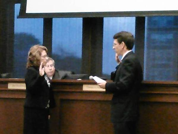 Robin LaBedz is sworn in as Arlington Heights Village Trustee by Mayor Thomas Hayes.