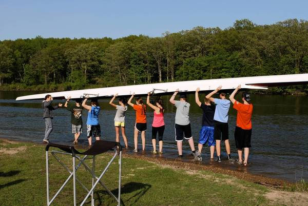 The St. Charles Rowing Club Prepares to enter the Fox River for practice.
