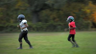 Respecting football's power to hurt and heal [Dude Mom]