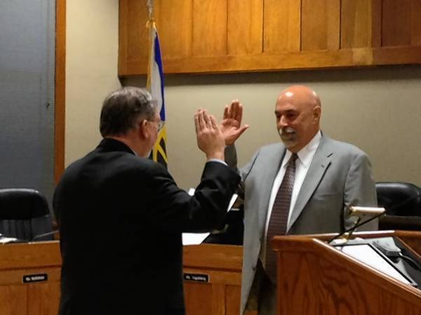 Tom Simonian is sworn in as Geneva's new Fifth Ward alderman Monday night.