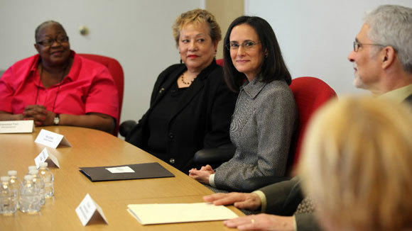 Illinois Attorney General Lisa Madigan and HUD Secretary Shaun Donovan meet in February with homeowners who have been helped by the National Foreclosure Settlement.