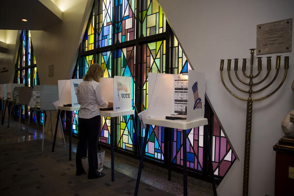Cindy White of Westwood casts her vote at Sinai Temple on Wilshire Boulevard.