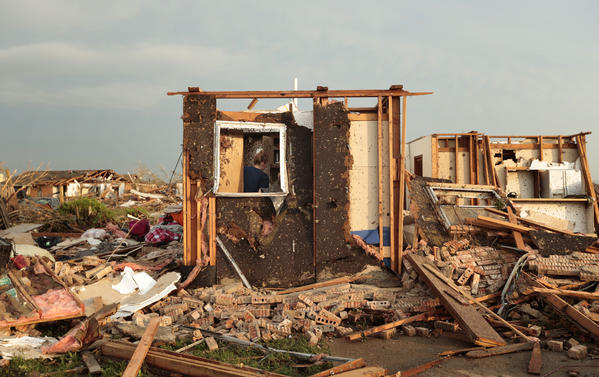 Dana Ulepich searches inside a room left standing at the back of her house destroyed after a powerful tornado ripped through the area in Moore, Oklahoma.