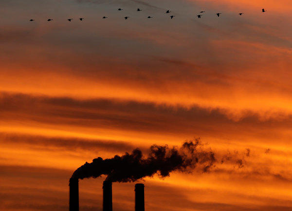 Smokestacks at the Jeffrey Energy Center coal power plant at sunset near Emmett, Kan.