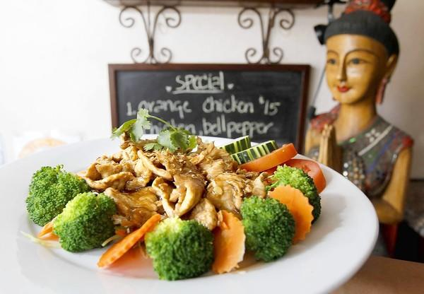 The garlic pork is a popular dish for the lunch crowd in downtown Laguna's Thai Bros. restaurant.