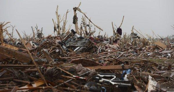 The rubble of homes in a destroyed neighborhood in Moore, Okla., on Tuesday. The town was hit by a tornado Monday, killing at least 24 people, many of them schoolchildren.
