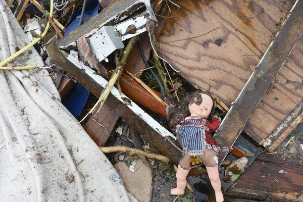 A doll sits in a pile of debris in a destroyed neighborhood in Moore, Oklahoma.