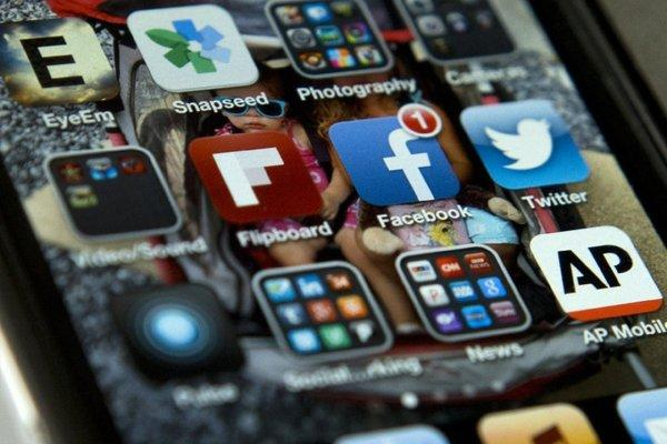 An iPhone showing the Twitter and Facebook apps, among others.