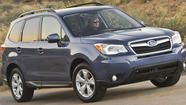The redesigned 2014 Subaru Forester captured the top spot in Consumer Reports' reviews of small SUVs.